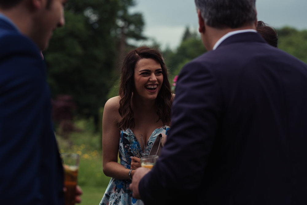 A Cumbria wedding guest laughs out loud at a joke