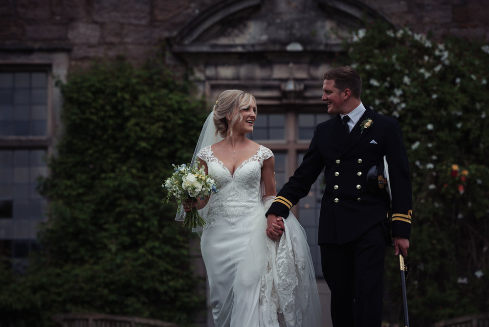 The bride and groom have their Cumbria Wedding Photography at Askham Hall