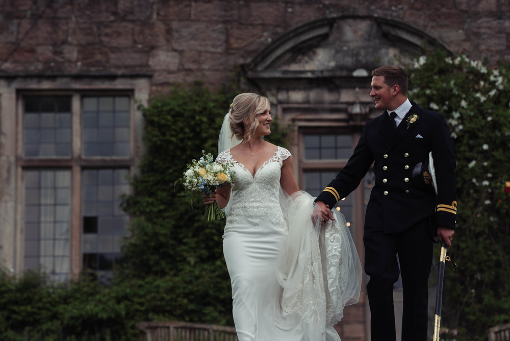 Massive smiles on the bride and groom as they walk hand in hand at Askham Hall