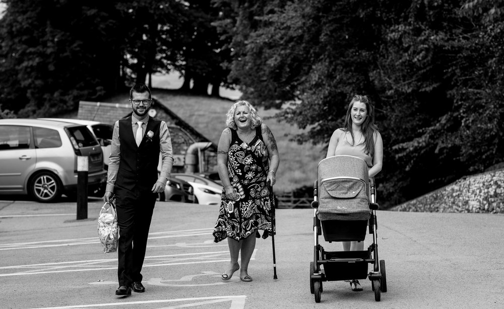 Guests are seen smiling as they walk towards the castle green hotel kendal