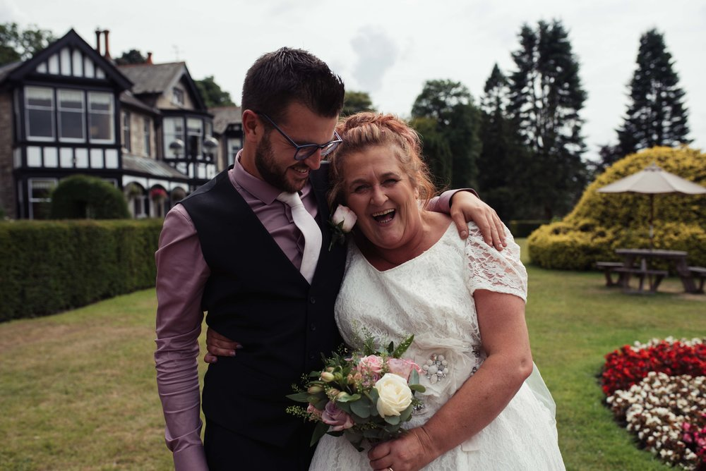 The best man makes the bride laugh in the grounds of the castle green hotel