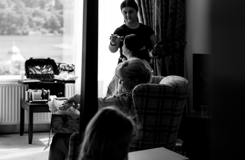 Mother of the bride looks at her wedding gifts