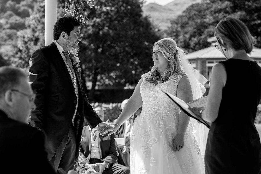 The bride and groom start to exchange their vows at the inn on the lake