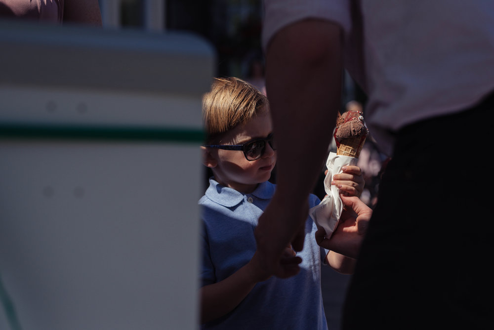 A young boy guest gets an ice cream at the wedding reception