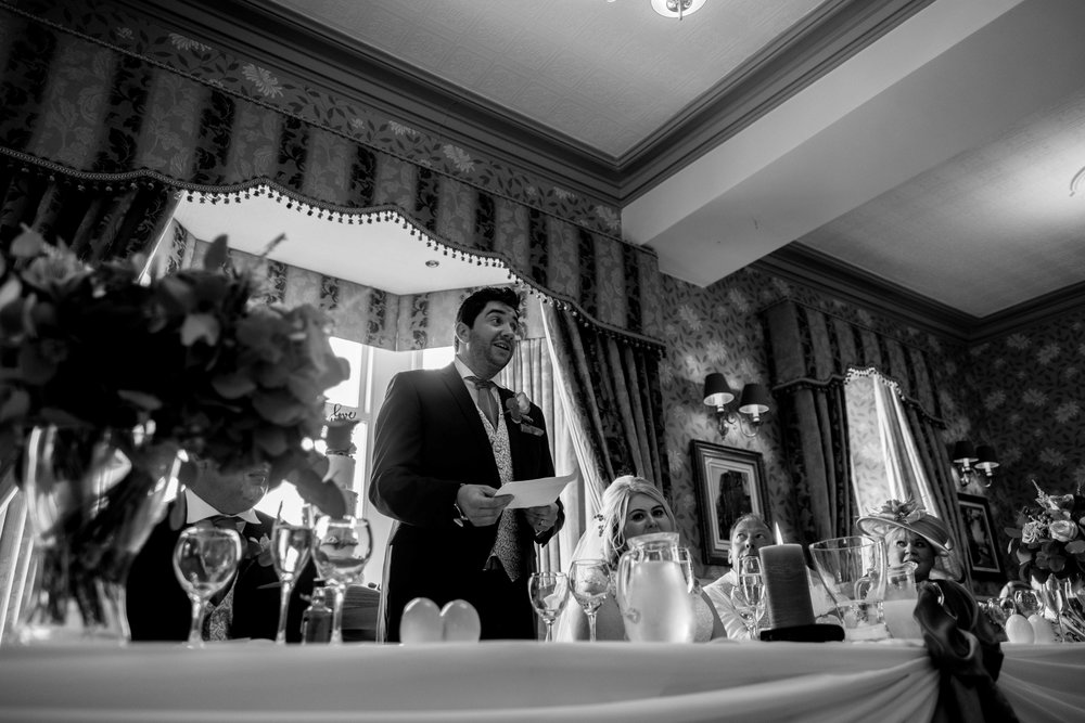 The groom and the top table while he delivers his speech