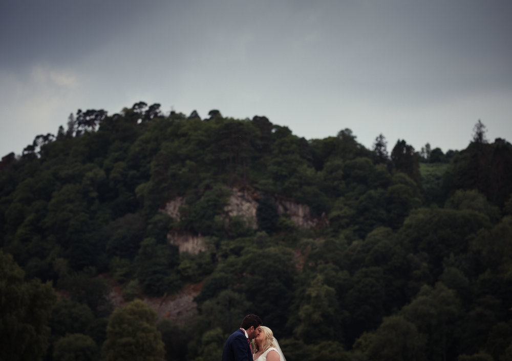 Cumbria Wedding photography in a field by Ullswater