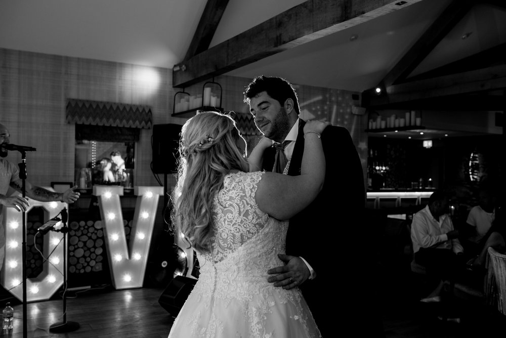The bride and groom have their first dance
