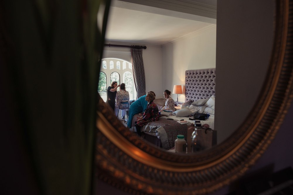 Makeup action through the mirror at the wedding venue