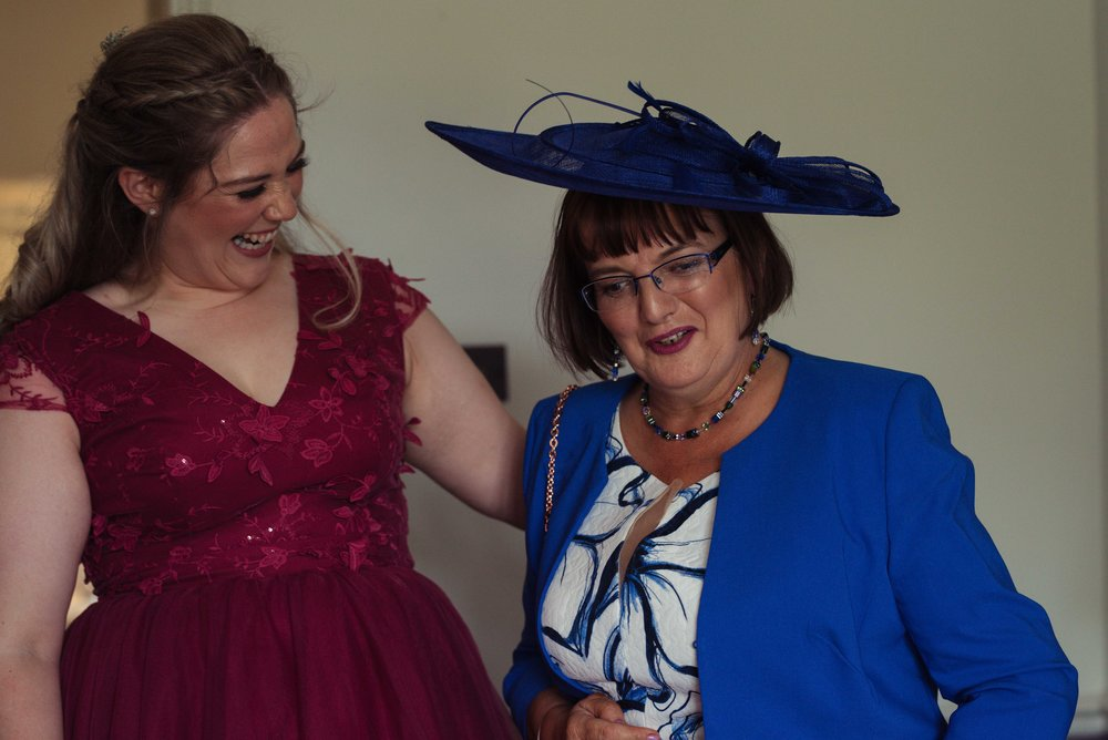 The brides mother and a bridesmaid dressed in burgundy