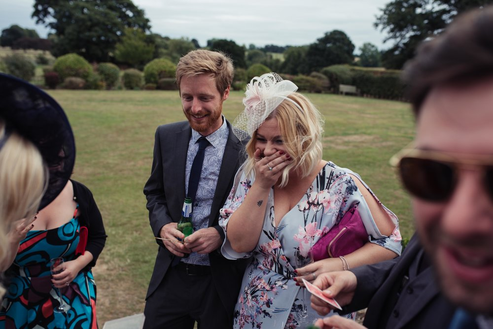 A wedding guest laughing her head off