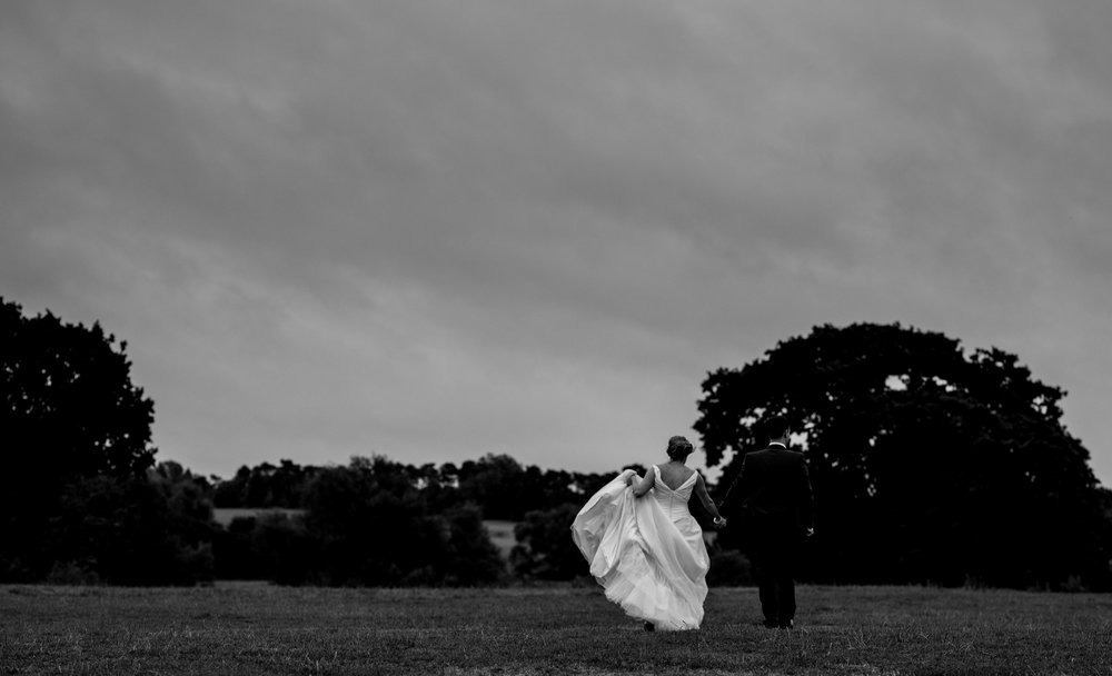 The bride and groom in an open field