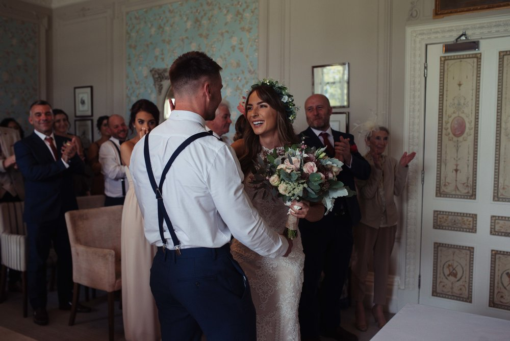 The bride and groom exchange their rings in their cumbria wedding