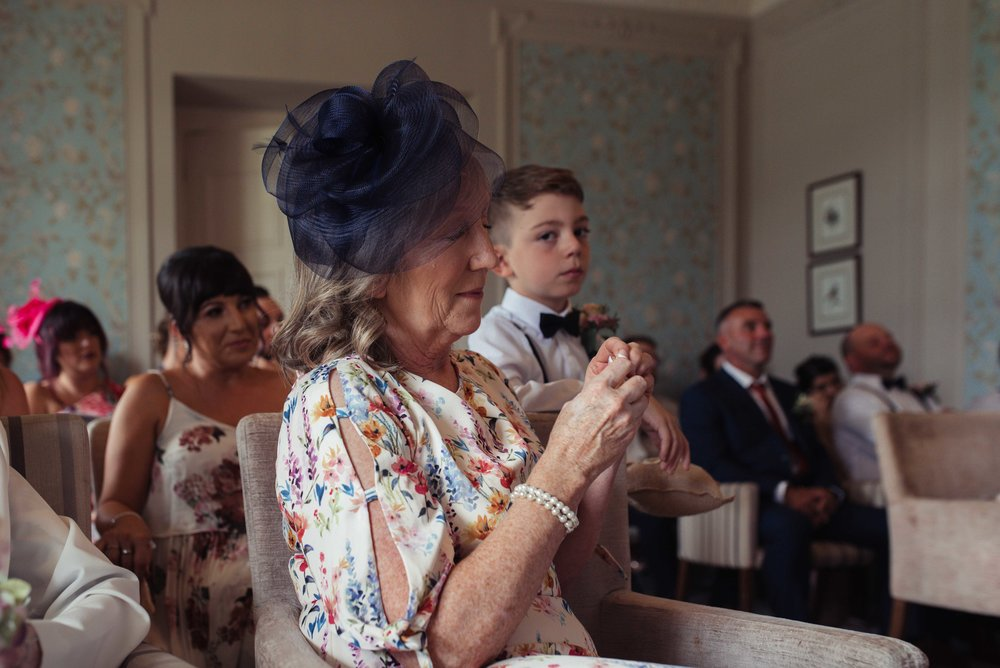 The mother of the groom in tears during the ceremony