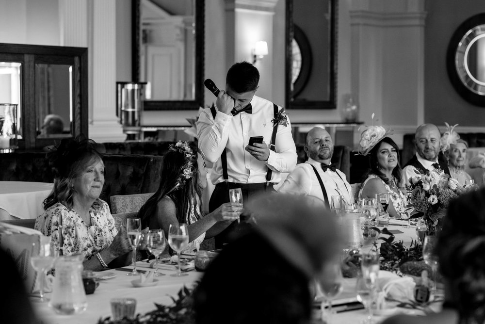 The groom wipes a tear from his eyes