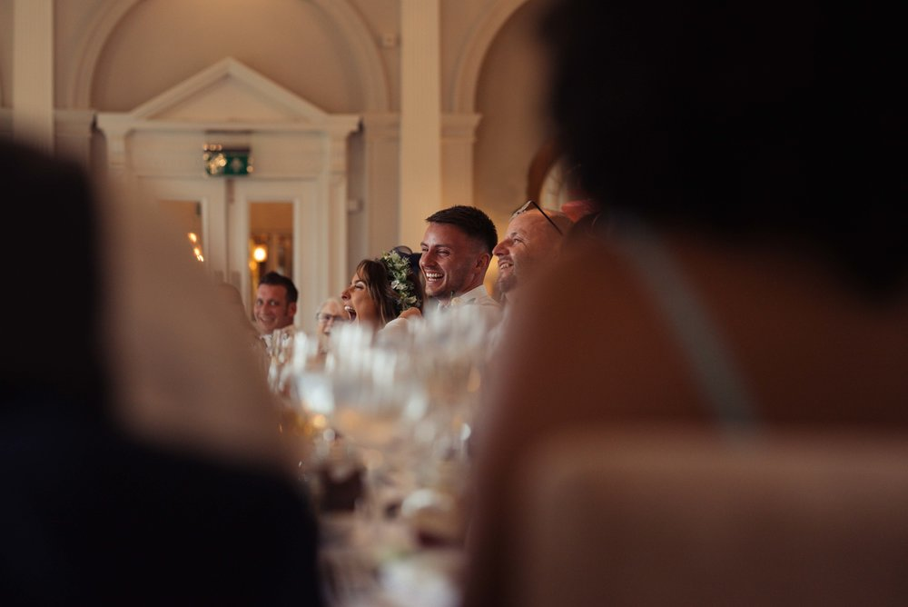 The groom laughs out loud during the best man speech