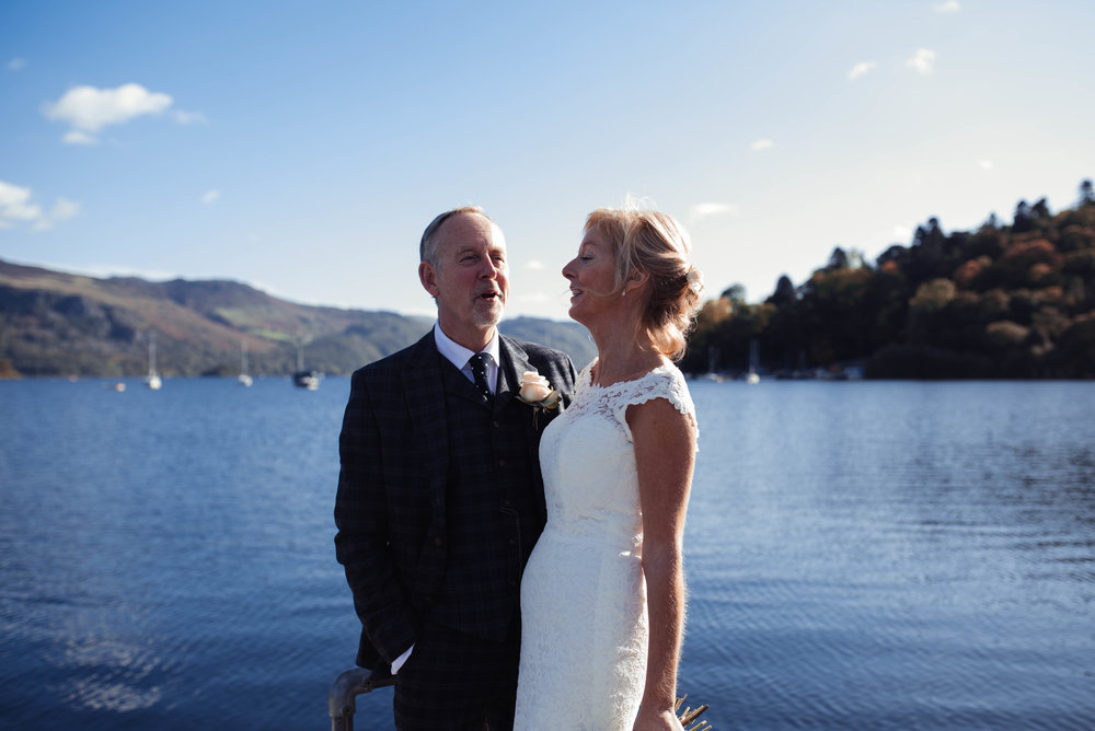 The bride and groom stand for their lake district wedding photography