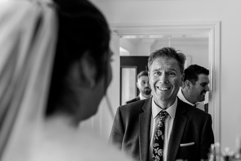 Father of the bride sees his daughter in a dress for the first time