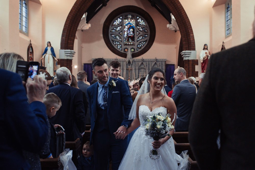 The bride and groom exit down the aisle