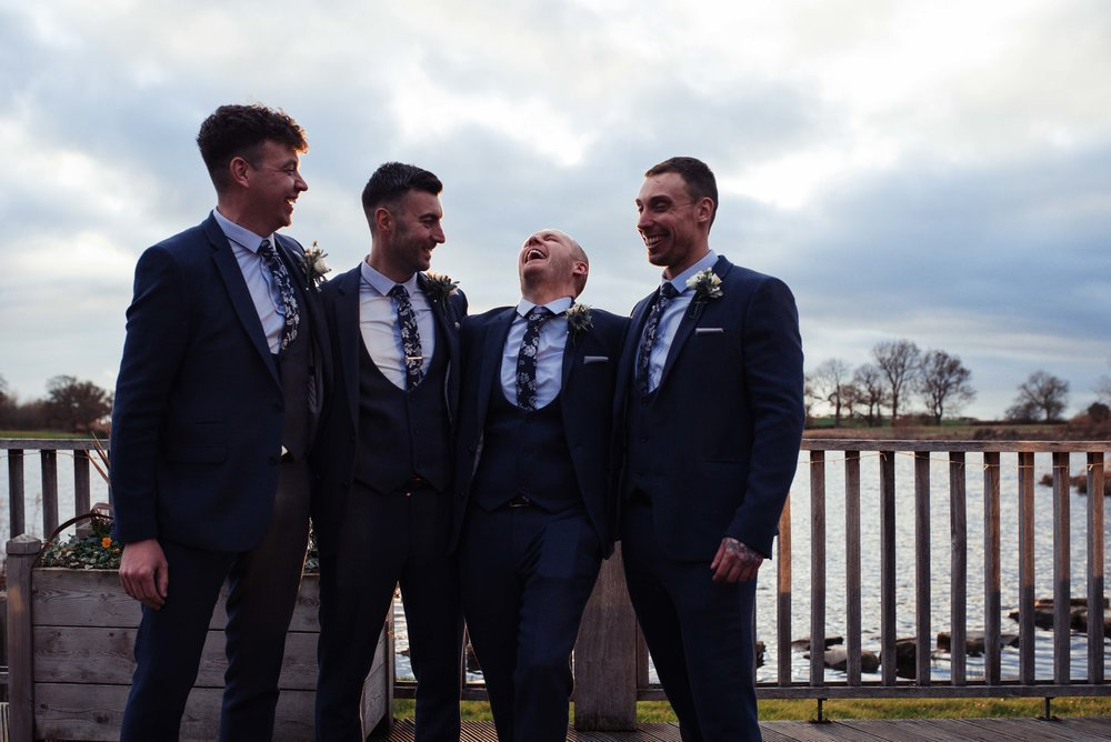 The groom and his ushers and best man pose for a photo