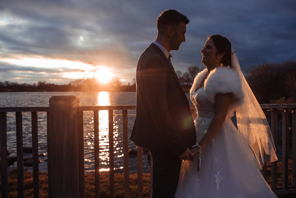 Sunset with a bride and groom at sandhole oak barn