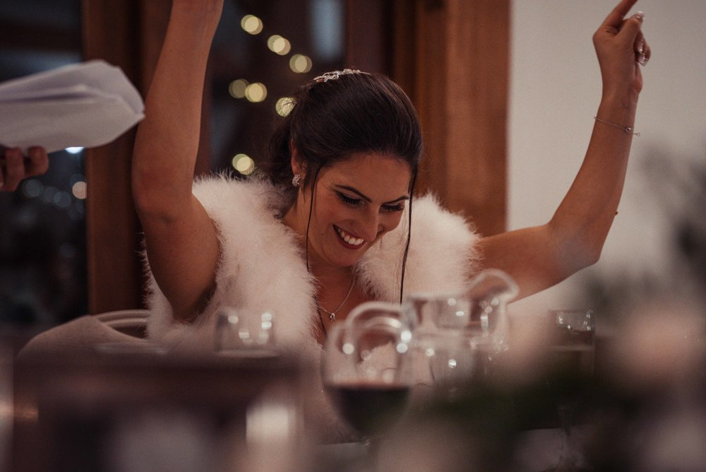 Bride looking really happy with her hands in the air