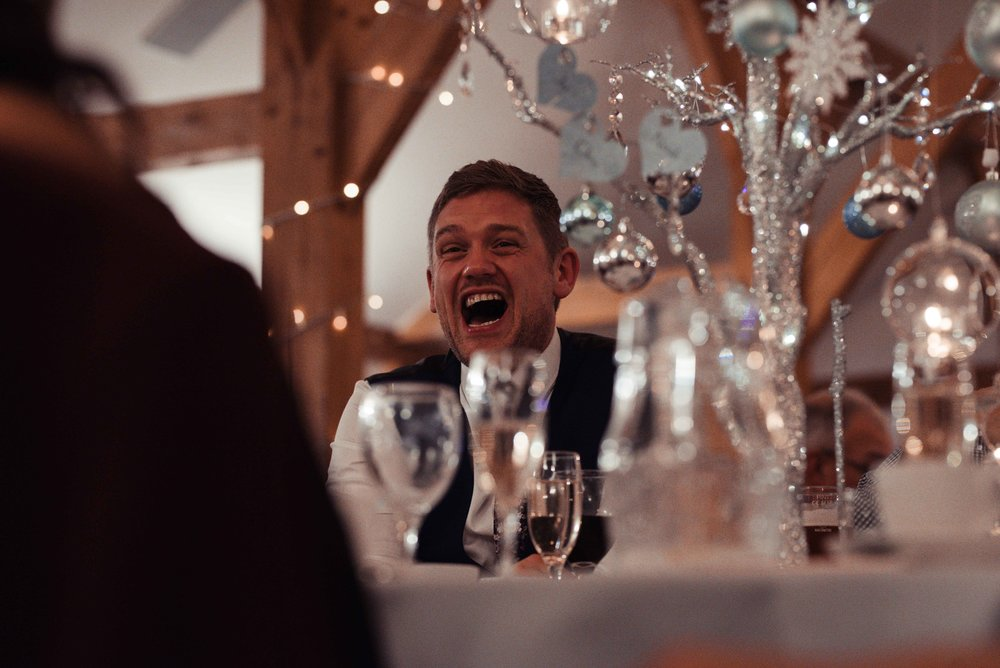 man laughs during the speeches