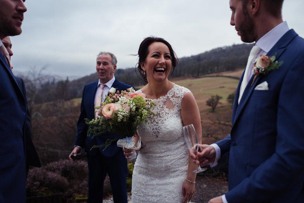 Bride laughs outside