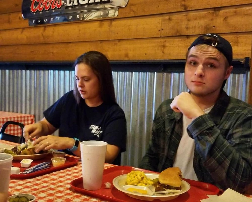 Kat and Dakota sharing a meal at CJ's BBQ before the Aggieland Scuba meeting
