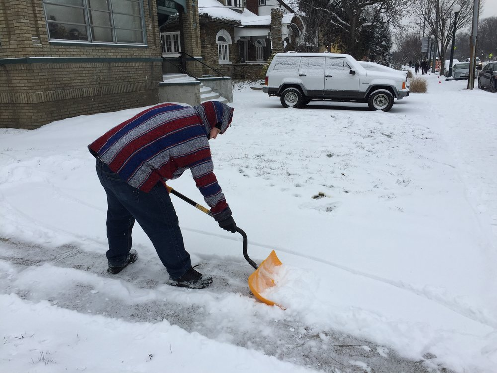 Matthew (from Texas) shoveling snow.