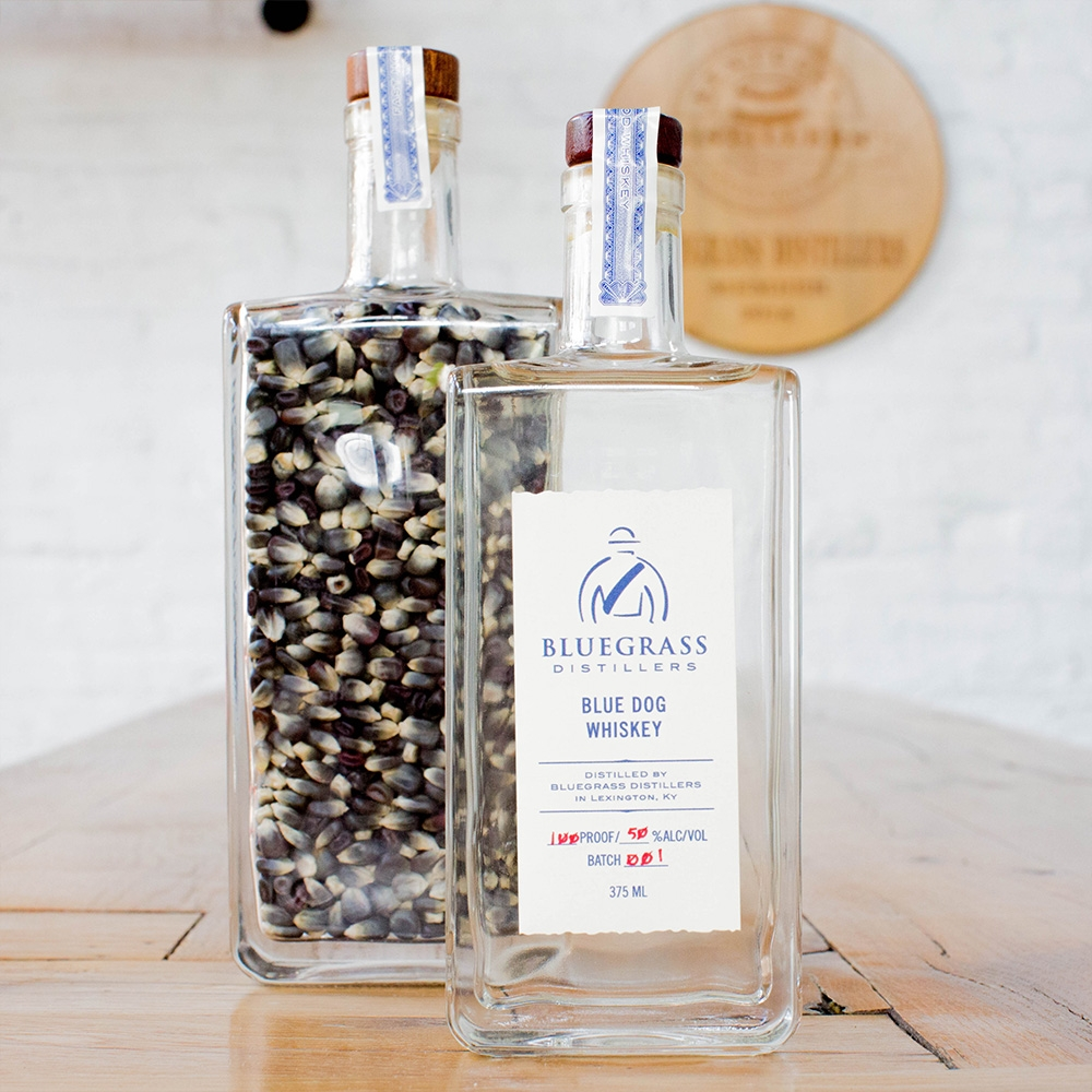 Blue Dog Whiskey - This unaged blue corn whiskey demonstrates the differences of corn flavors. Blue corn has a more mellow, earthy flavor compared to the sweetness of yellow corn. In this Blue Dog, the notable flavors are floral such as a Mezcal or Tequila while still being noticeably corn.