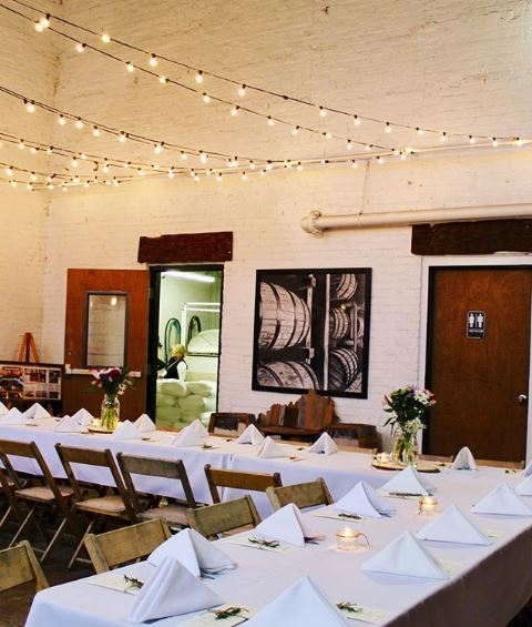 An intimate wedding rehearsal dinner emphasized by rustic details and the evening sun.