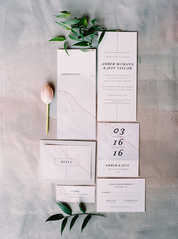 Modern wedding invitations with a nod to a marble and minimalist theme.
