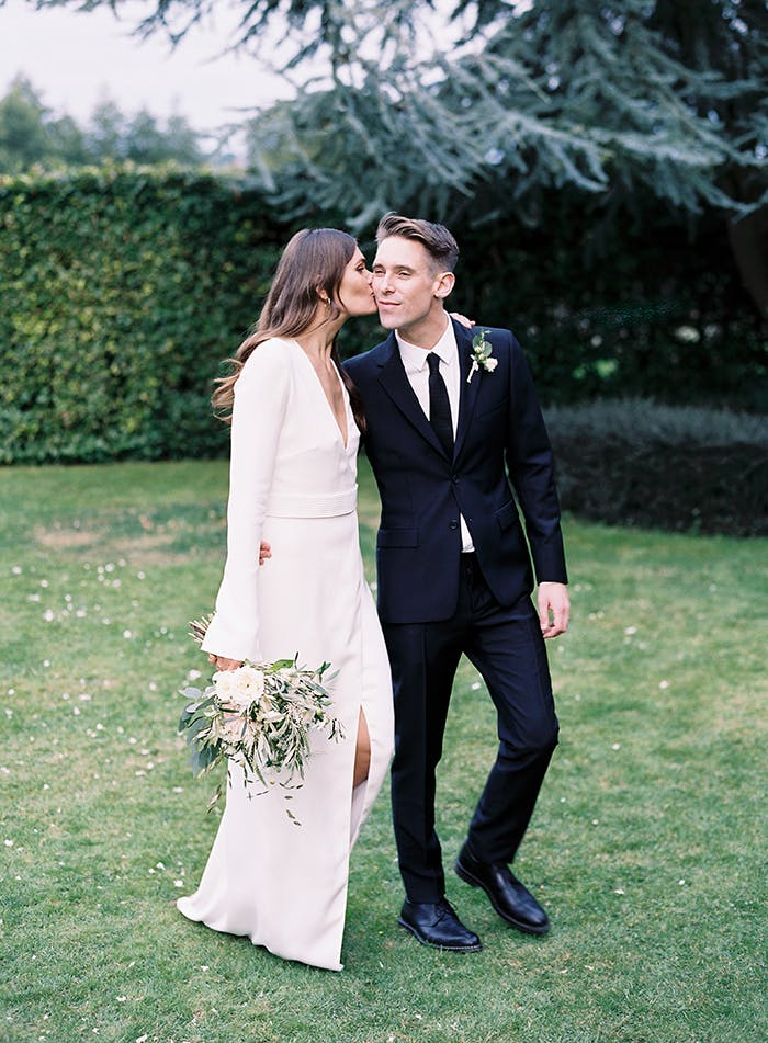 This minimalist bride and groom opt for modern attire for their nuptials.
