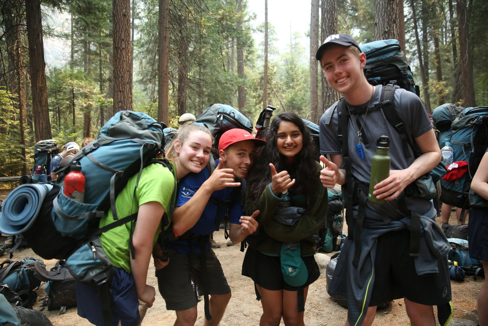 students celebrate their return to the trailhead after 9 days in the backcountry.
