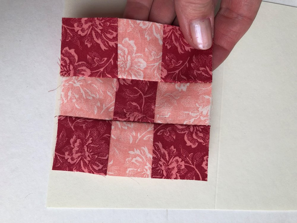 nine-patch quilt block in red and pink