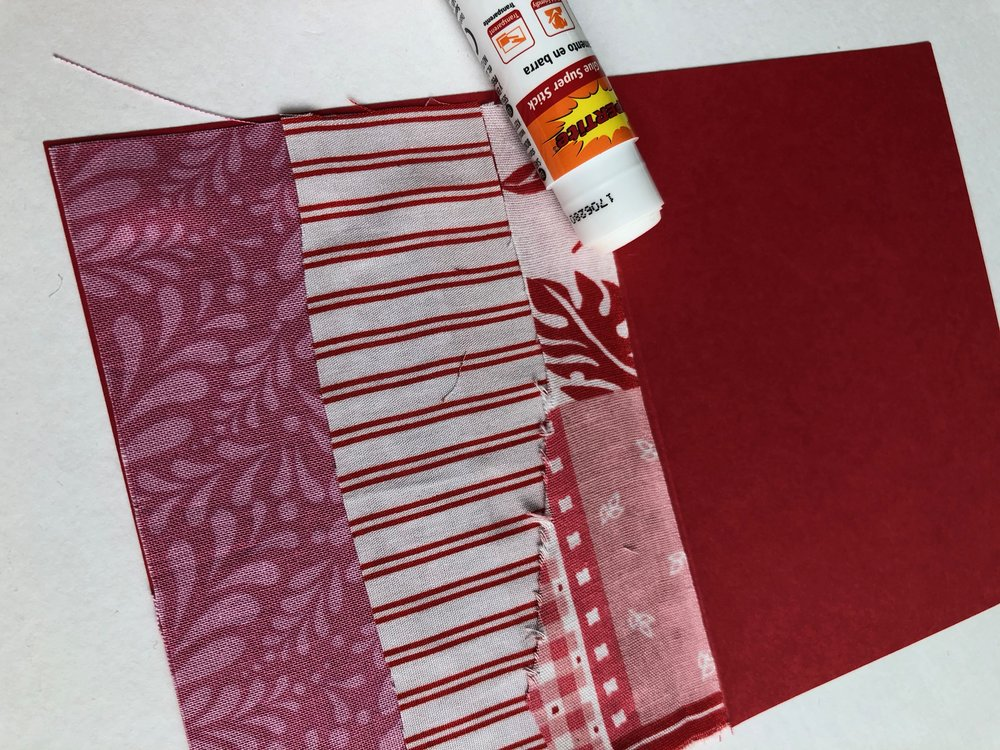 2 - Use a light amount of glue to attach to your card. The child-friendly Supertite glue stick I used dries in about five minutes.Now it's time to use some stitching to enhance your card! Use some unique stitches on your machine or use a needle and thread to hand sew. I suggest using a dull needle or just accepting the fact that the needle you use will be dull after sewing through paper:)