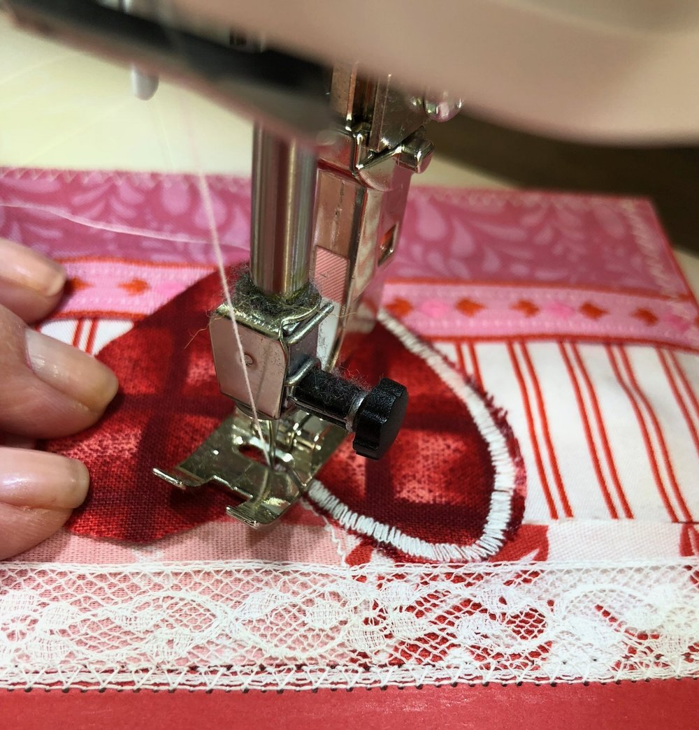 3 - Now it's time to use some stitching to enhance your card! Use some unique stitches on your machine or use a needle and thread to hand sew. I suggest using a dull needle or just accepting the fact that the needle you use will be dull after sewing through paper. :)Keep adding a variety of stitches to your card, using dense stitchings to make some areas of your card stand out. I used straight line stitches, zig zag stitches, and satin stitches to attach my embellishments to the card.