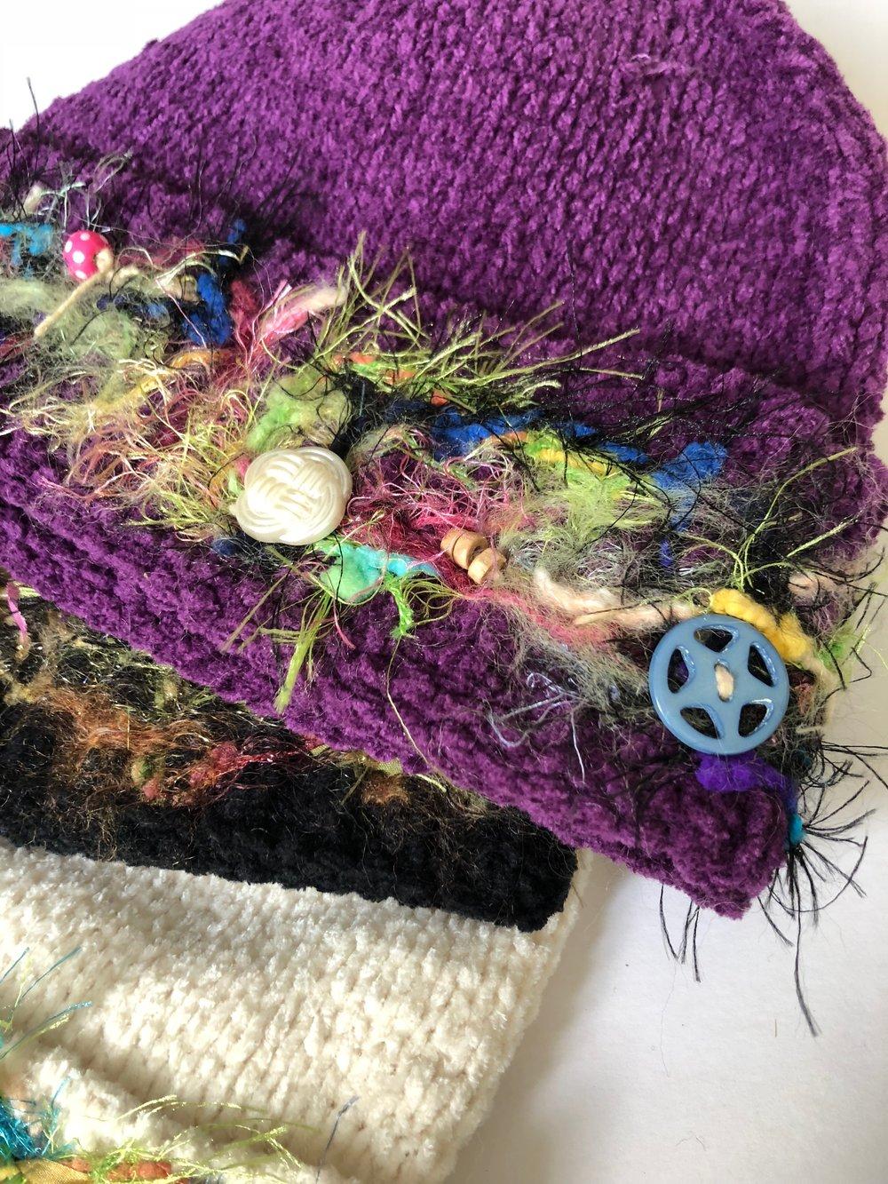 Needle felted embellished knit hats