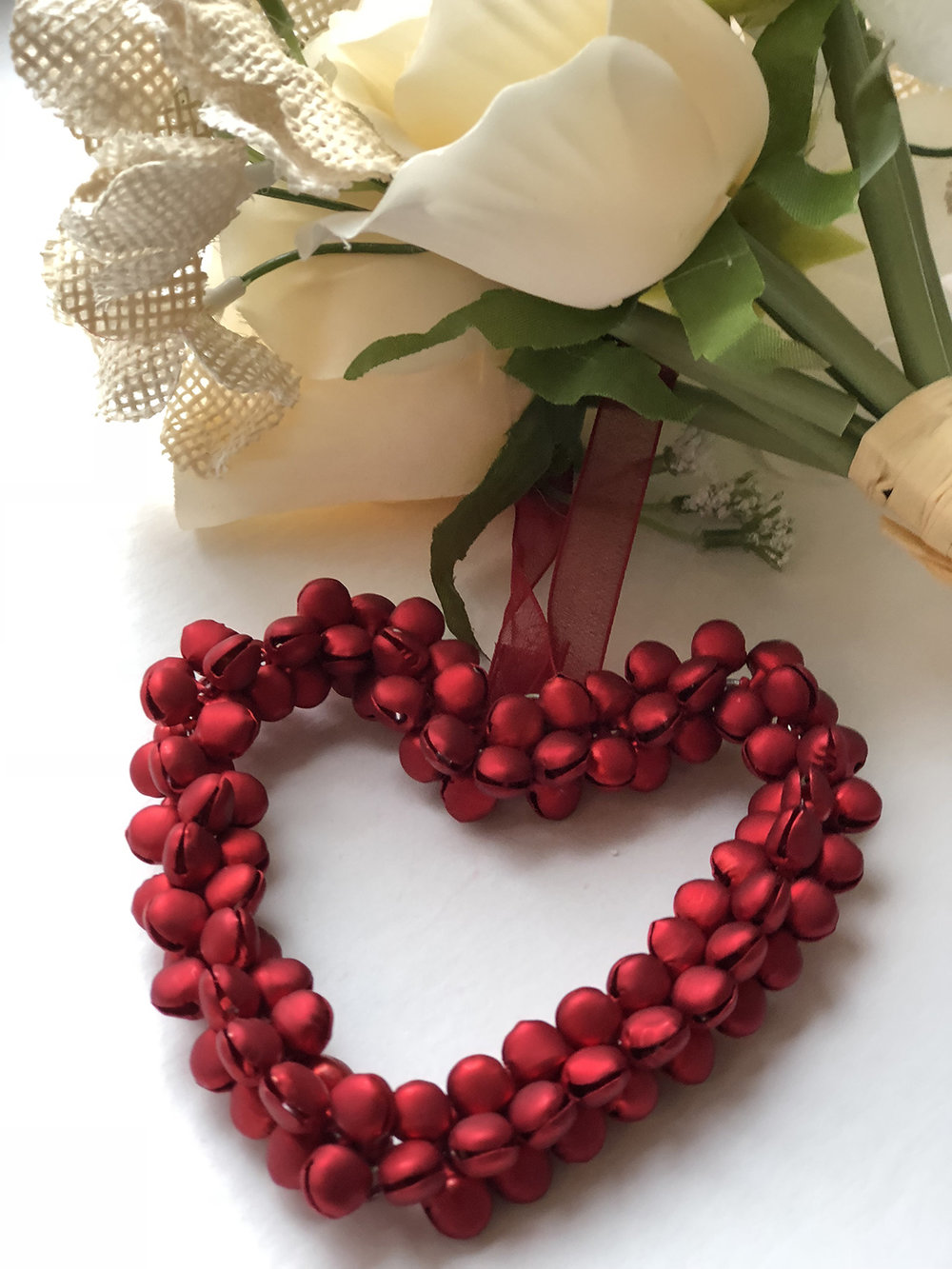 Red metal beads wired into a heart ornament