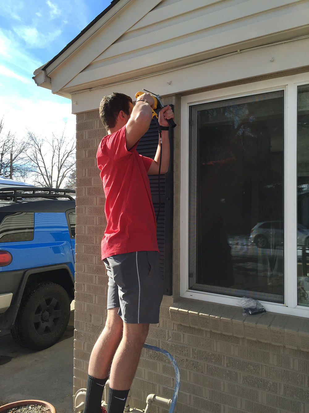 Man repairing exterior window