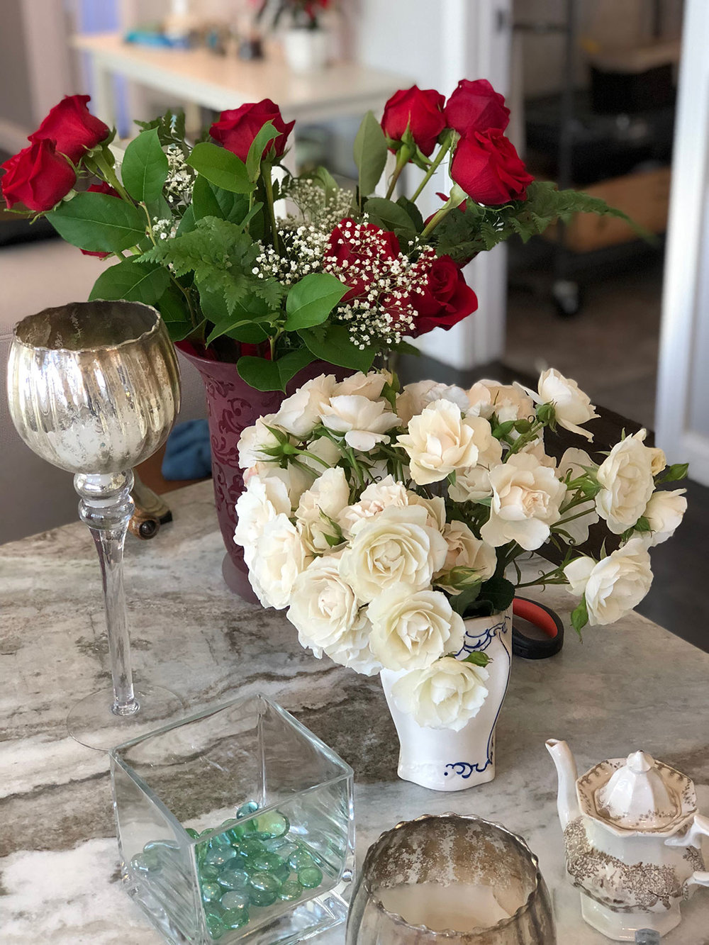 Red roses and white roses arranged in vases