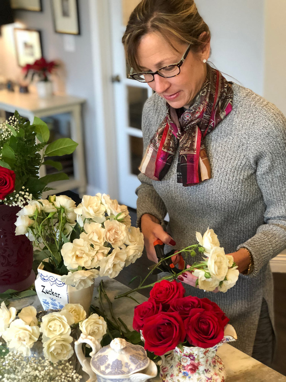 woman-arranging-valentine-roses