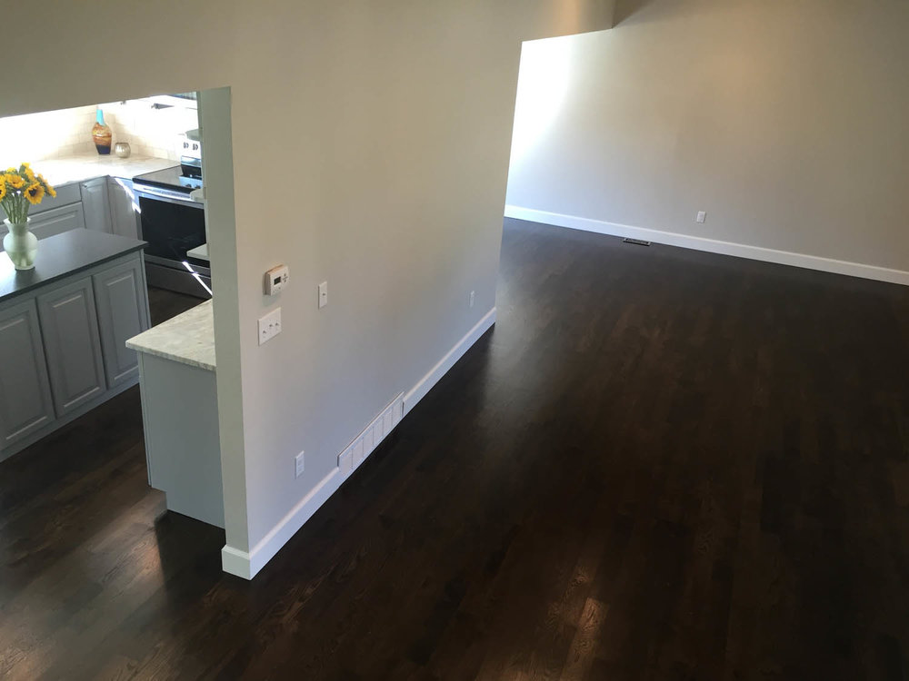 New hardwood flooring with a dark stain