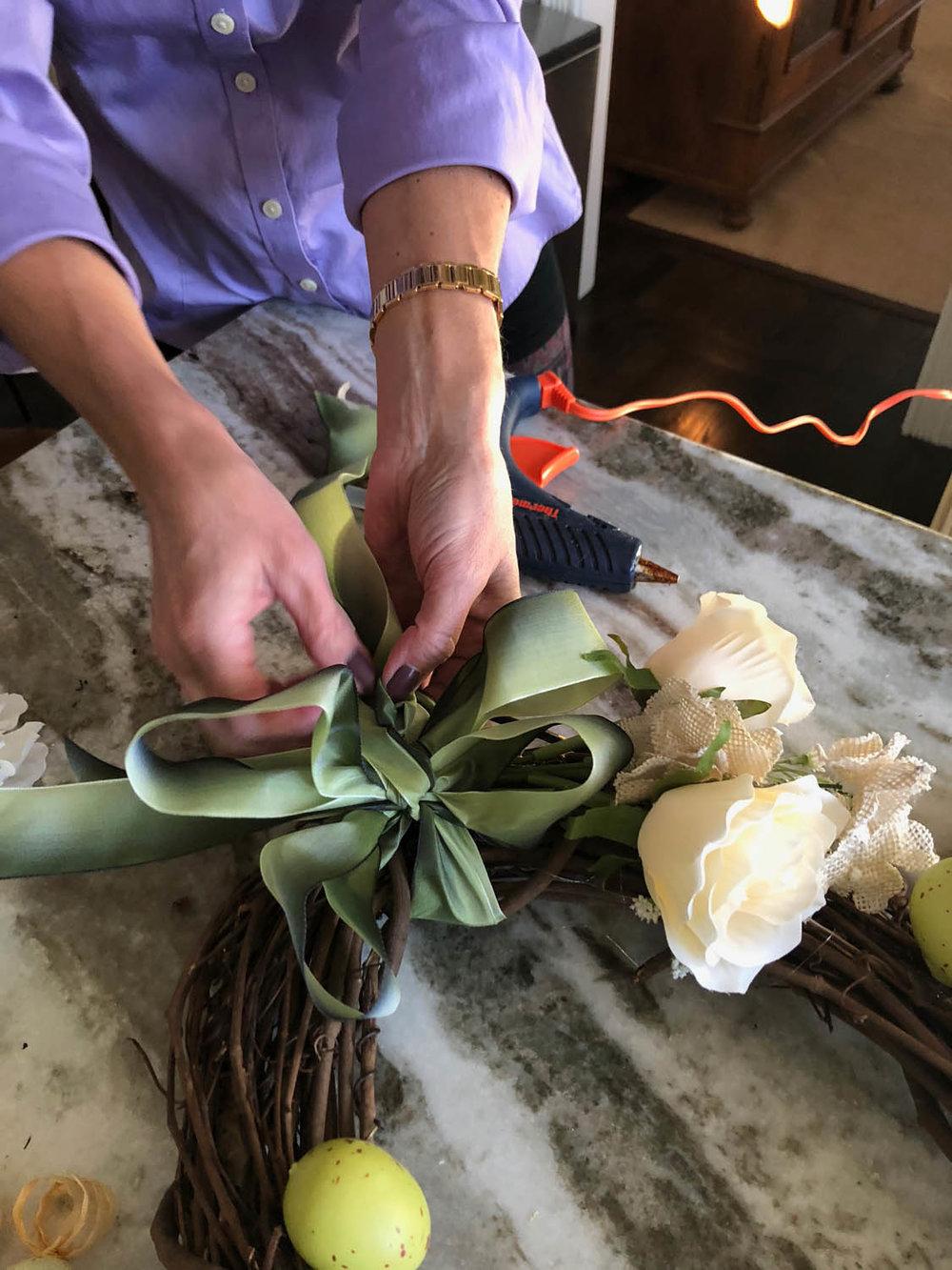 tie satin ribbon bow onto wreath