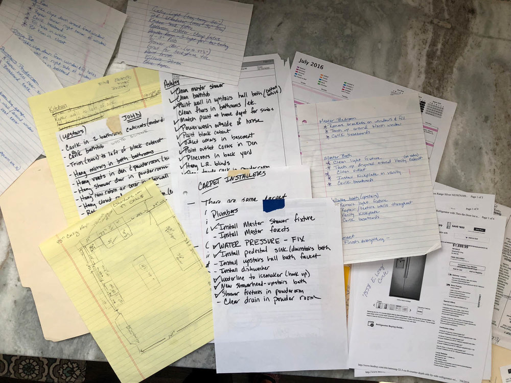 A pile of notes to track all the house remodeling tasks during the flip