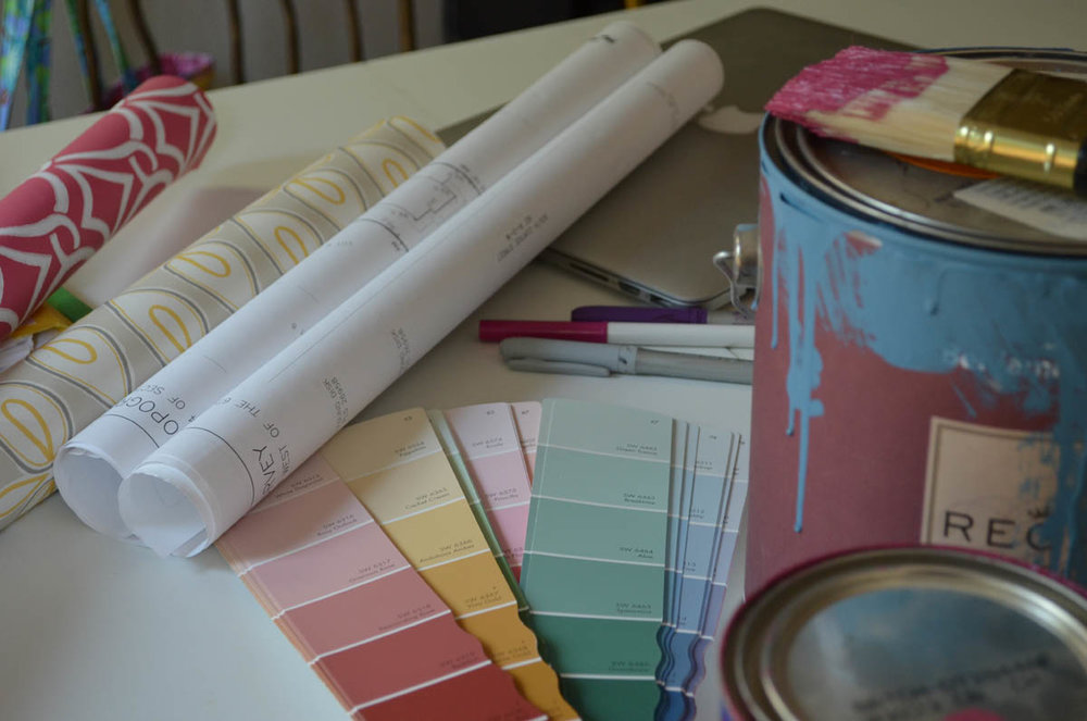 Colors swatches, wallpaper and paint samples for redecorating house flip