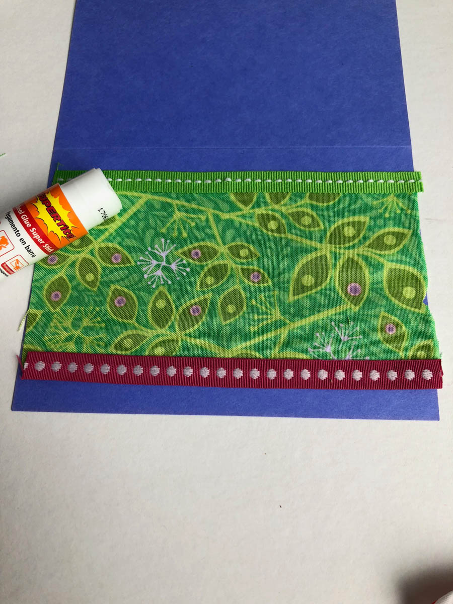 Glue embellishments to card