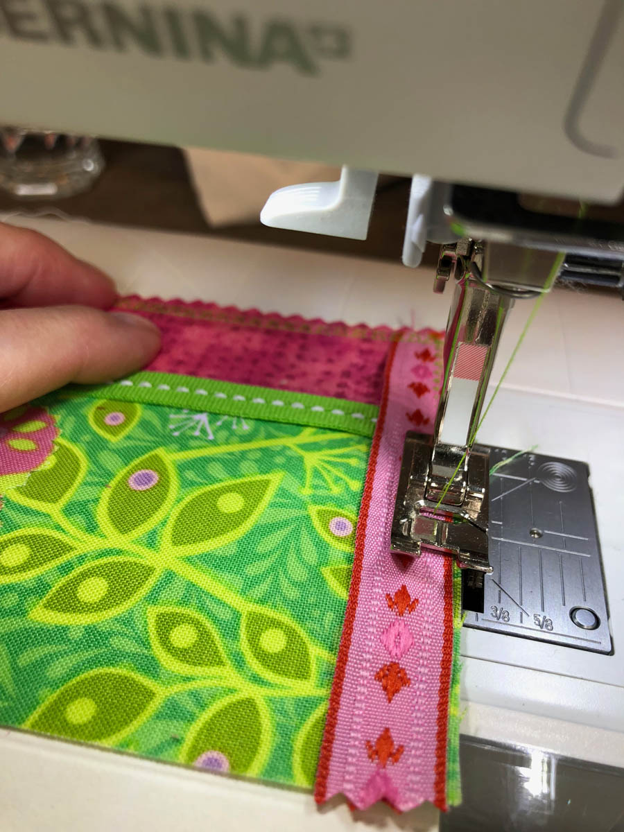 Stitch glued embellishments to card