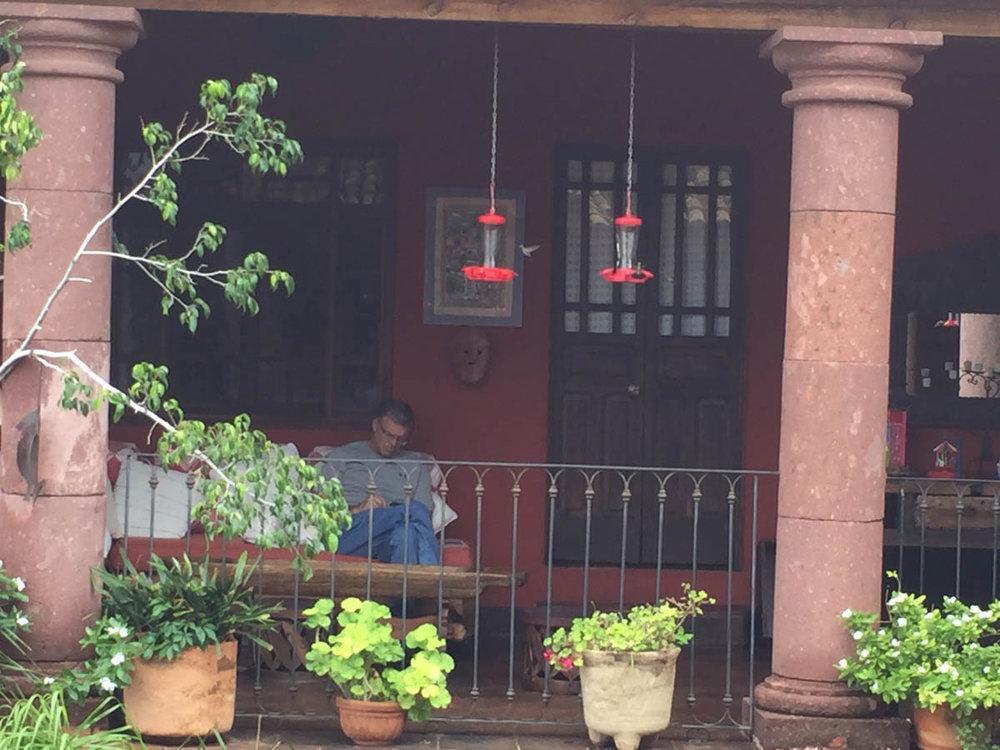 Casa de la Cuesta porch view hummingbird feeders
