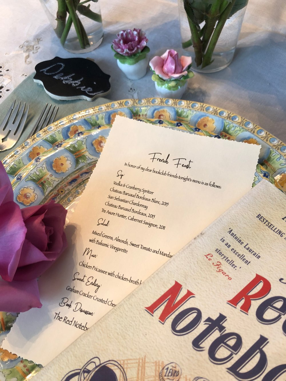 Place setting, menu, and The Red Notebook
